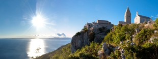 Sunset at Ancient town of Lubenice and cliff in Cres